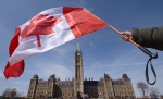 A Canadian flag flies over Parliament Hill in Ottawa, Ont., in this file photo.
