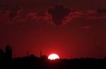 The sun sets behind Istanbul's skyline, Tuesday, July 14, 2015. (Lefteris Pitarakis / AP Photo)