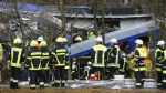 Rescue personnel stand in front of two trains that collided head-on near Bad Aibling, southern Germany, Tuesday, Feb. 9, 2016. (AP / Matthias Schrader)