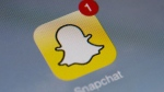 The Snapchat app showing a notification in this undated photo. (AFP PHOTO/LIONEL BONAVENTURE)