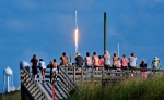 Crowds pack the Canaveral National Seashore Friday, May 27, 2016, to witness the liftoff of a SpaceX Falcon 9 rocket with the THAICOM-8 satellite aboard, from Launch Complex 40 at the Cape Canaveral Air Force Station. (Craig Rubadoux / Florida Today via AP)