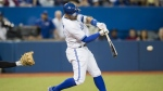 Toronto Blue Jays' Kevin Pillar hits an RBI single against the New York Yankees during the seventh inning of MLB baseball action in Toronto on Tuesday May 31, 2016. (Mark Blinch / THE CANADIAN PRESS)