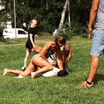 In this photo provided by Jenny Kitsune Adolffson, Swedish police officer Mikaela Kellner is pinning a man to the ground who is suspected to have stolen a friend's mobile phone as she said, in Stockholm Sweden, Wednesday, July 27, 2016. She was off duty and wearing a bikini but that didn't stop her from apprehending the man. (Jenny Kitsune Adolfsson via AP)