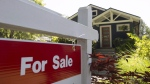 A sold sign is pictured outside a home in Vancouver, B.C., Tuesday, June, 28, 2016. (THE CANADIAN PRESS/Jonathan Hayward)