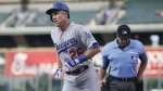 Los Angeles Dodgers' Chase Utley heads to the dugout after hitting a solo home run off Colorado Rockies starting pitcher Jeff Hoffman to lead off the first inning of the second game of a baseball doubleheader Wednesday, Aug. 31, 2016, in Denver. (AP / David Zalubowski)