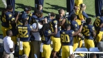Michigan football players raise their fists up in protest during the National Anthem, before an NCAA college football game against Penn State, Saturday, Sept. 24, 2016, in Ann Arbor, Mich. (Junfu Han / The Ann Arbor News via AP)