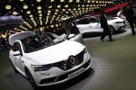 The Renault Talisman on display during the first press day at the Paris Auto Show in Paris, France, Thursday, Sept. 29, 2016. (AP Photo/Christophe Ena)
