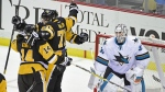 Pittsburgh Penguins left wing Chris Kunitz, centre Evgeni Malkin and Pittsburgh Penguins right wing Patric Hornqvist celebrate the winning goal in front of San Jose Sharks goalie Martin Jones during the third period of an NHL hockey game in Pittsburgh on Thursday, Oct. 20, 2016. (AP / Fred Vuich)