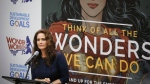 """Lynda Carter, who played Wonder Woman on television, speaks during a UN meeting to designate Wonder Woman as an """"Honorary Ambassador for the Empowerment of Women and Girls,"""" Friday, Oct. 21, 2016 at UN headquarters. (Bebeto Matthews/AP)"""