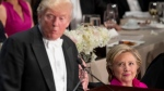 Republican presidential candidate Donald Trump, left, accompanied by Democratic presidential candidate Hillary Clinton, right, speaks at the 71st annual Alfred E. Smith Memorial Foundation Dinner, a charity gala organized by the Archdiocese of New York, Thursday, Oct. 20, 2016, at the Waldorf Astoria hotel in New York. (AP Photo/Andrew Harnik)