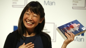 """Writer Madeleine Thien, poses for the media with her book """"Do Not Say We Have Nothing"""" during a photocall for the 6 shortlisted authors for the Man Booker Prize for fiction in London, Monday, Oct. 24, 2016. (AP / Alastair Grant)"""