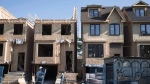 Houses under construction in Toronto are seen in a June 26, 2015, file photo. (Graeme Roy/THE CANADIAN PRESS)