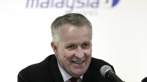 Malaysia Airlines CEO Peter Bellew smiles after a singing ceremony with Boeing in Putrajaya, Malaysia, Wednesday, July 27, 2016. (AP / Vincent Thian)